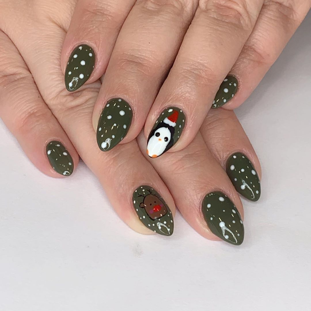 Green finger nails for Christmas with reindeer accent