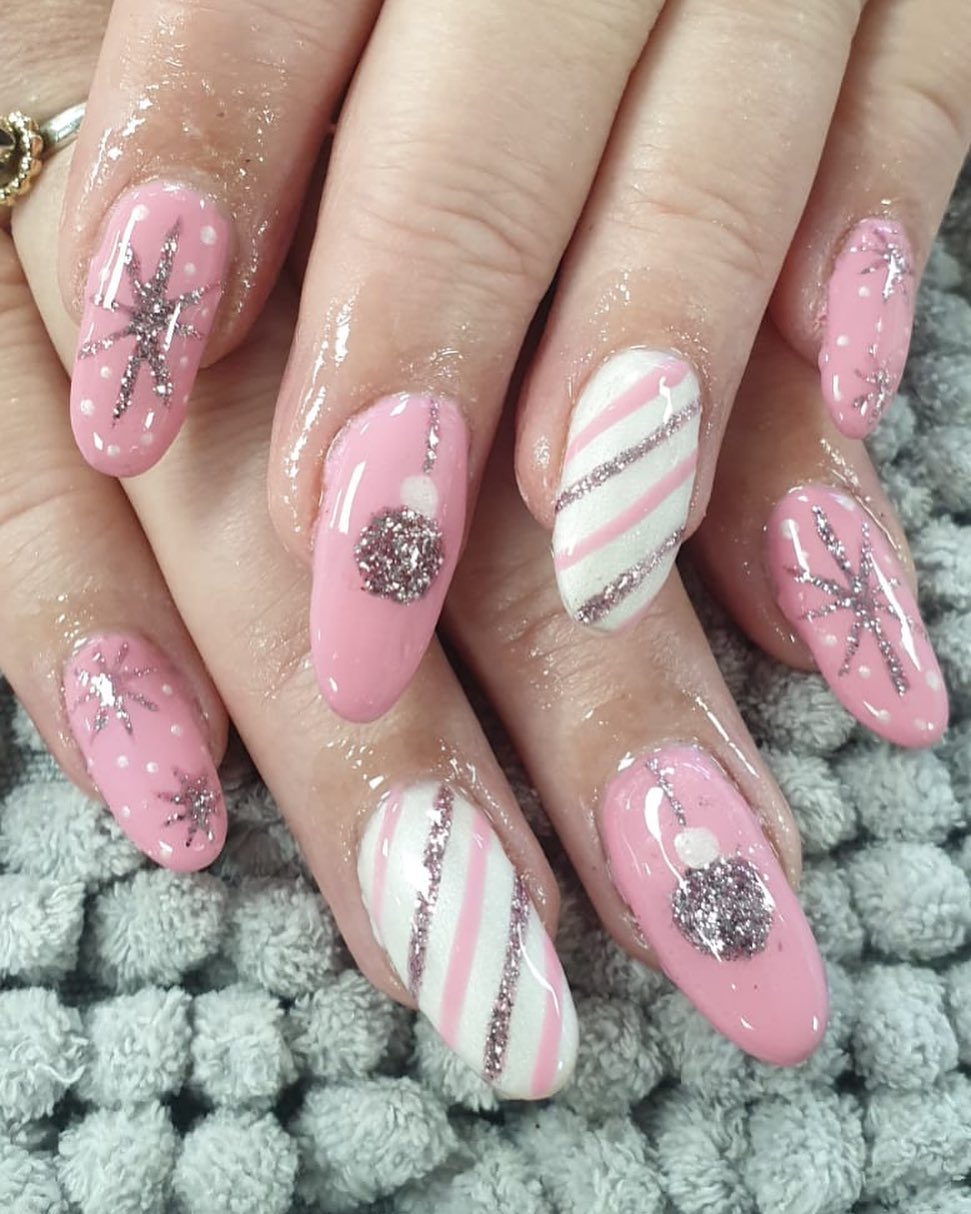 Image of cute Christmas nails in pink stripes and glitter