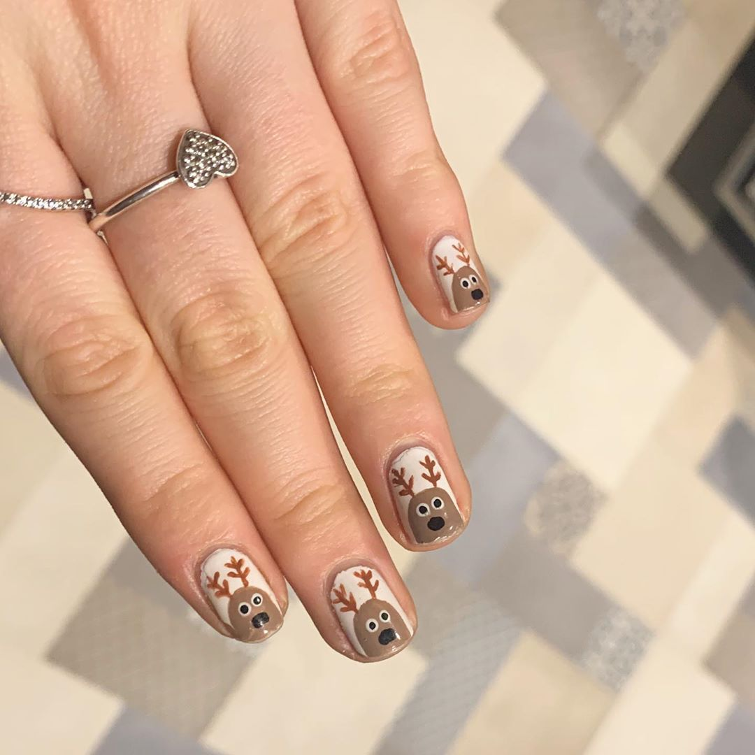 Fingernails painted with Reineer on each nail