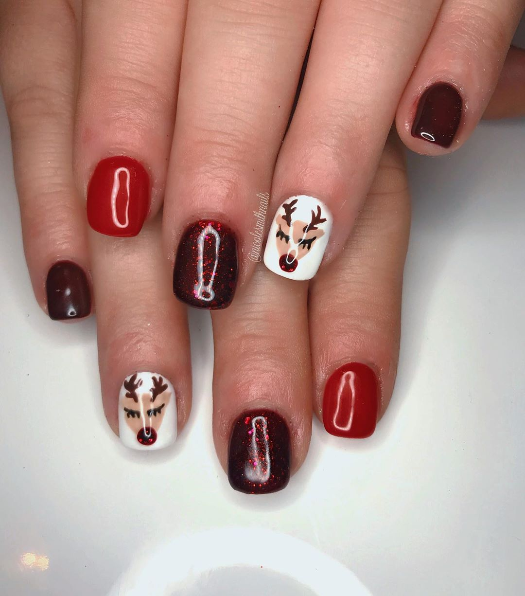 Variety of red Christmas nail designs