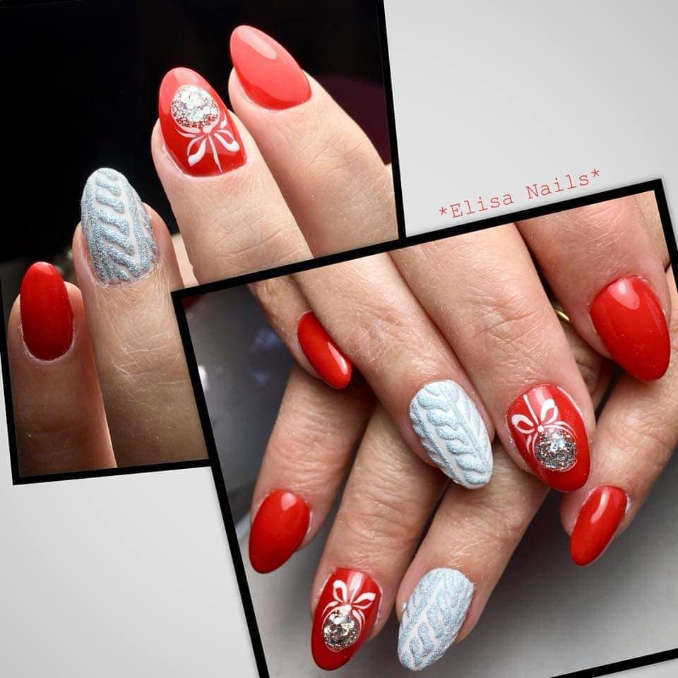 Nails decorated with red and white and Christmas ornament
