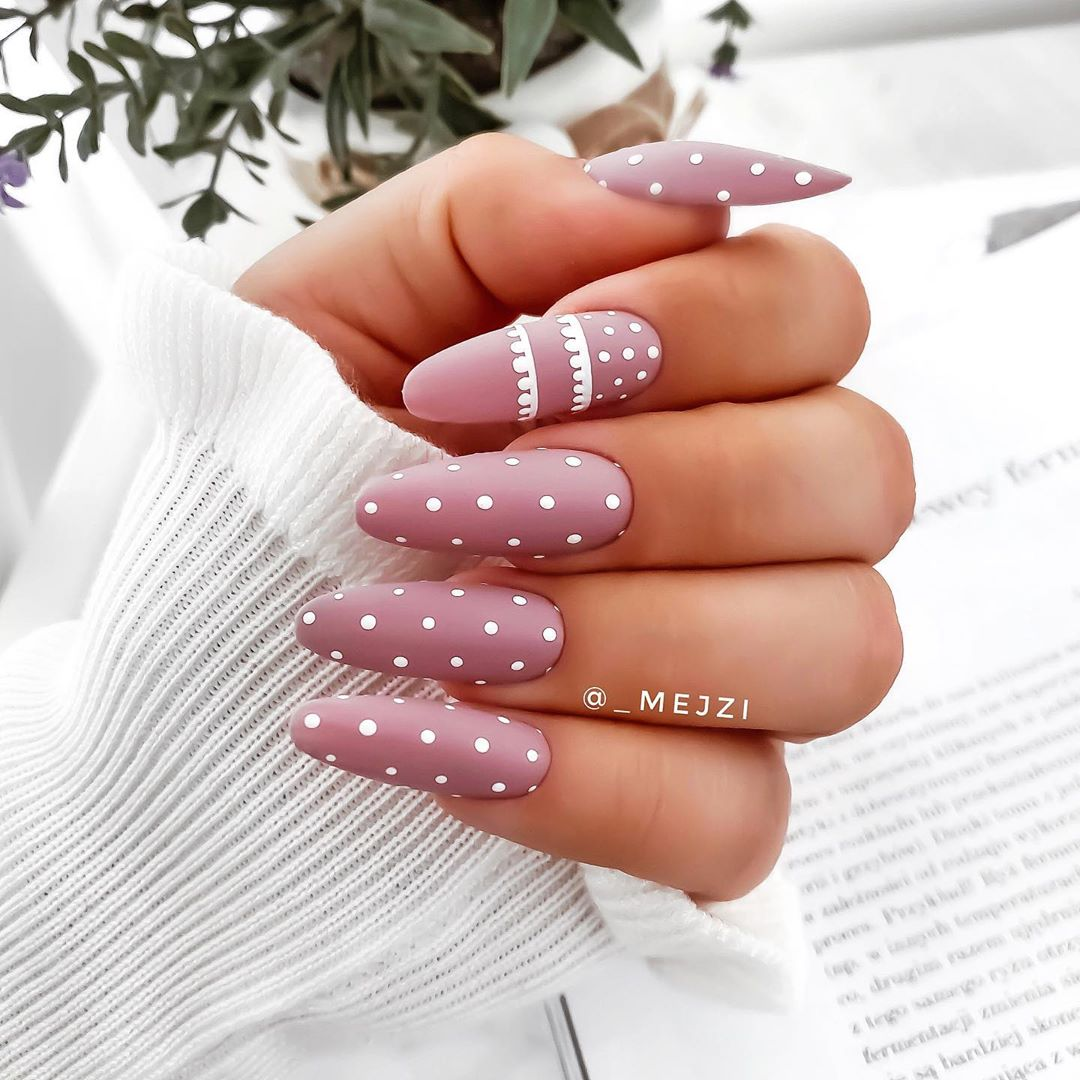 Image of Christmas nail designs with a pink color