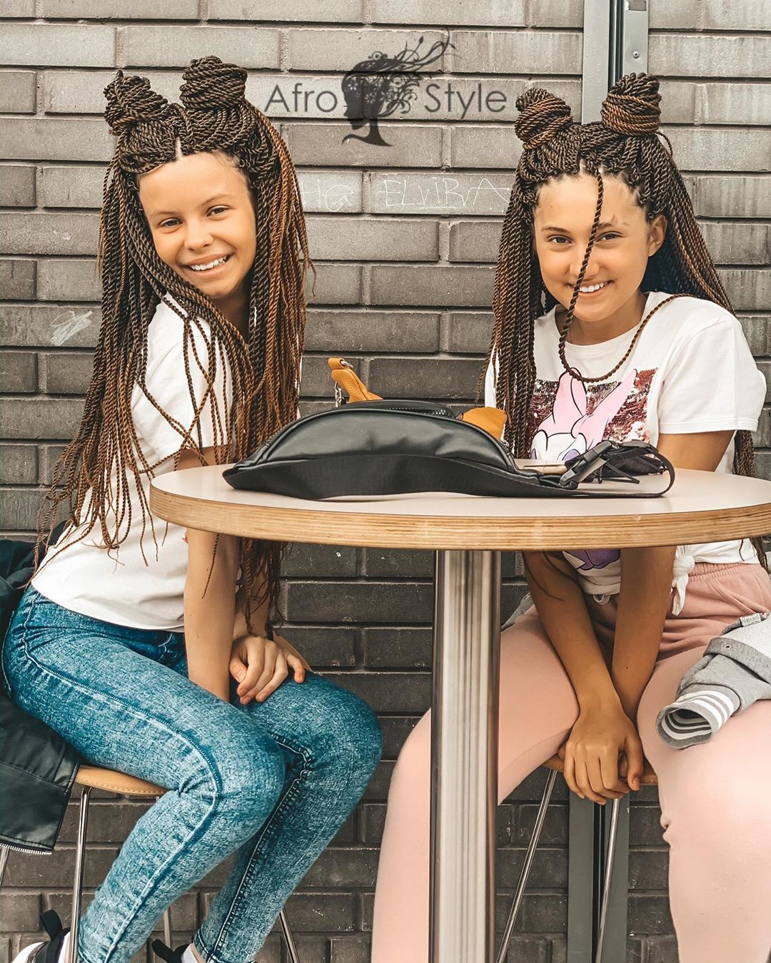 Two girls sporting Senegalese Twists