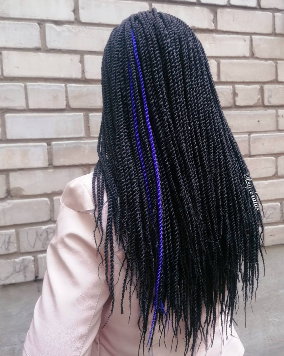 Blue strand of colored hair in senegalese twist hairstyle
