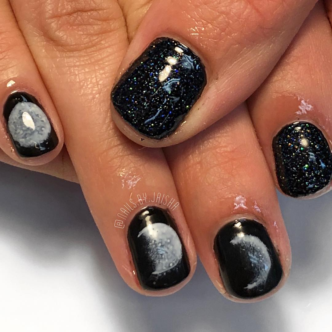 Bold image of a stunning black sparly nail look